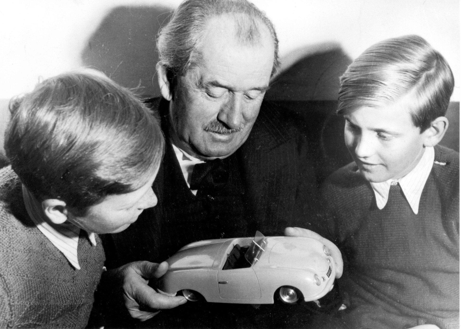 Ferdinand Porsche with two of his grandchildren