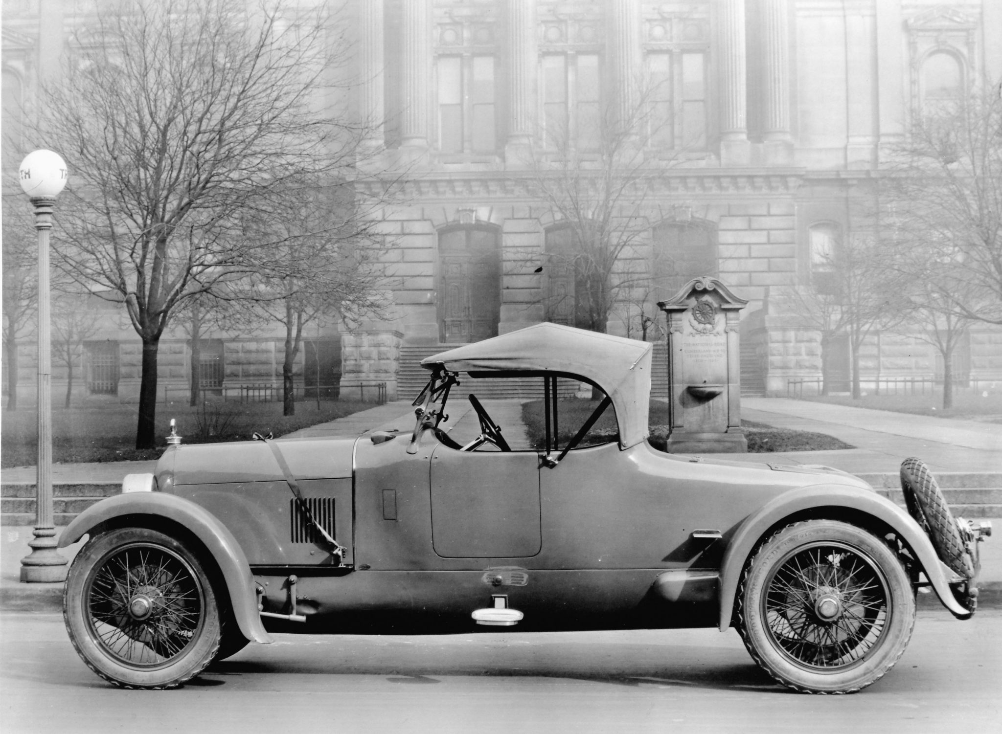 This was obviously someone's very expensive gift, as evidenced by the ribbon tied around the hood. This unusual 1922 Duesenberg roadster is parked in front of a monument to The National Road (later part of U.S. Route 40) that ran from Cumberland, Maryland, to Terra Haute, Indiana, where this photograph was taken. The coachbuilder is unknown but the long rear deck, cycle fenders and absence of running boards certainly make this an interesting design.