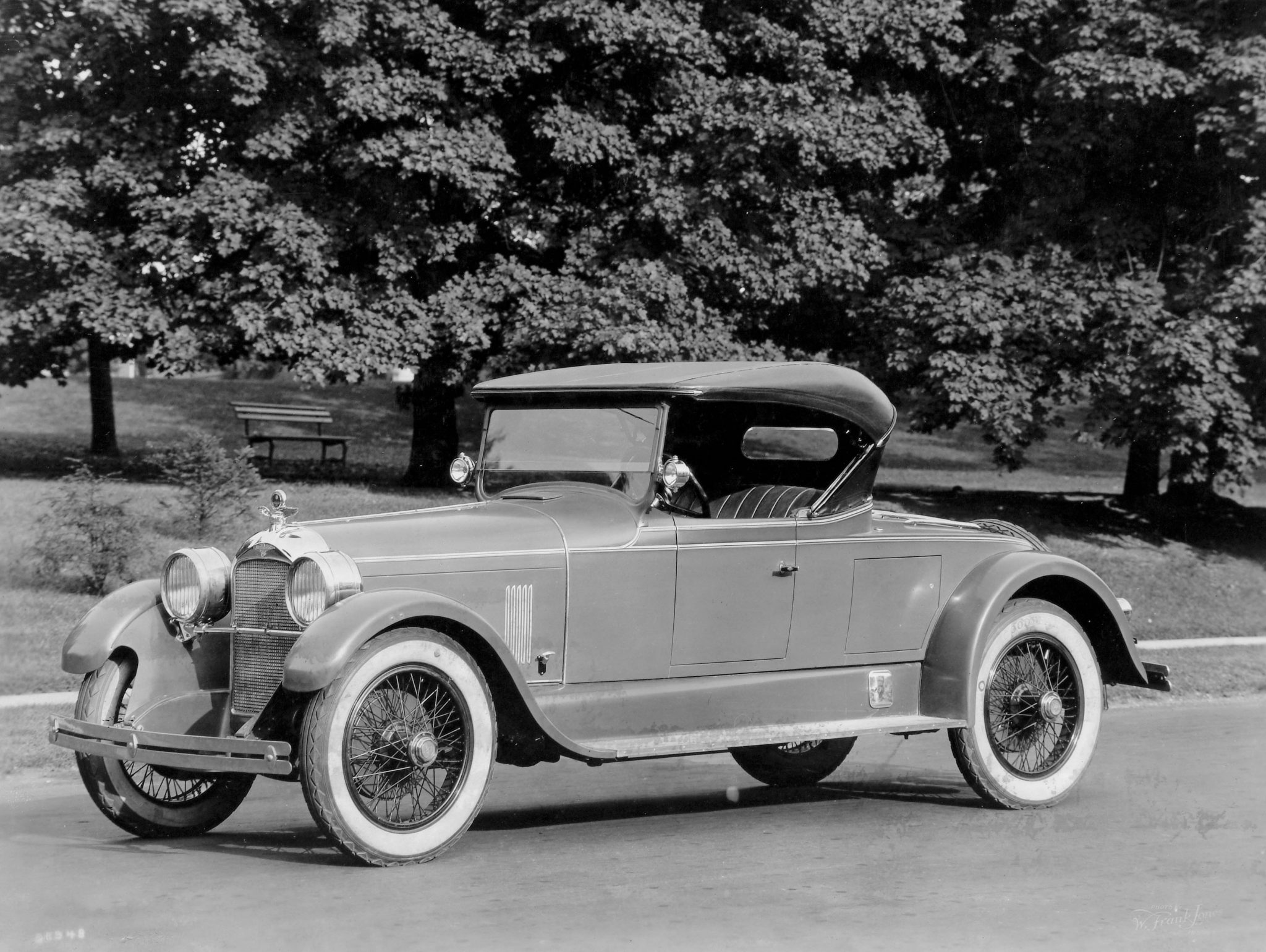 Another superb example of Duesenberg Model A styling, a sporty 1923 roadster with coachwork by Rubay. Once again note the small, swiveling sidelights attached to the windshield frame. The car is also equipped with a golf bag door on the driver's side.