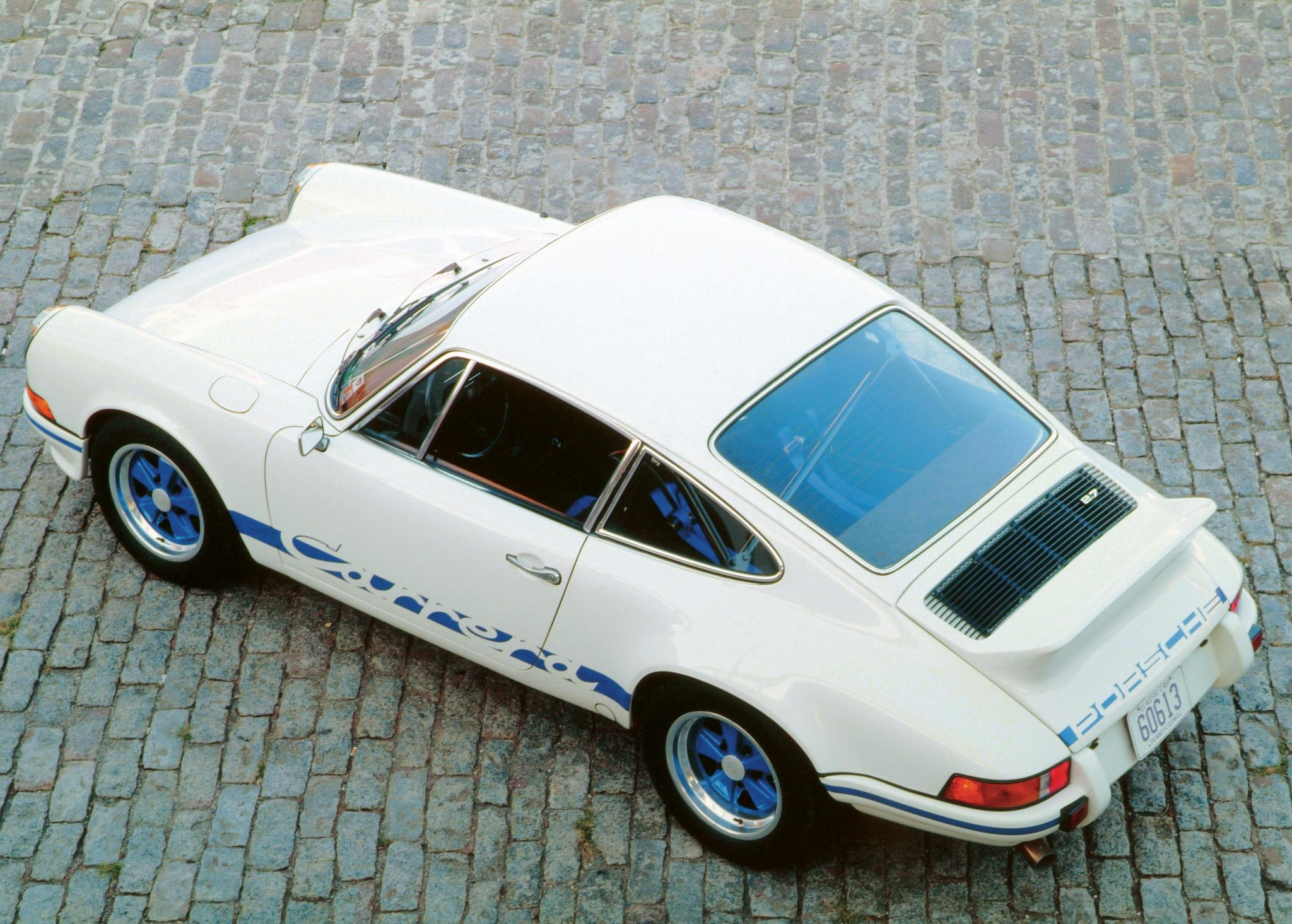 1973 porsche carrera rs 27 the ultimate classic 911 heacock note the porsche name painted across the decklid the elevated view also shows the angle of the ducks tail or brzel the spoiler greatly reduced vanachro Choice Image