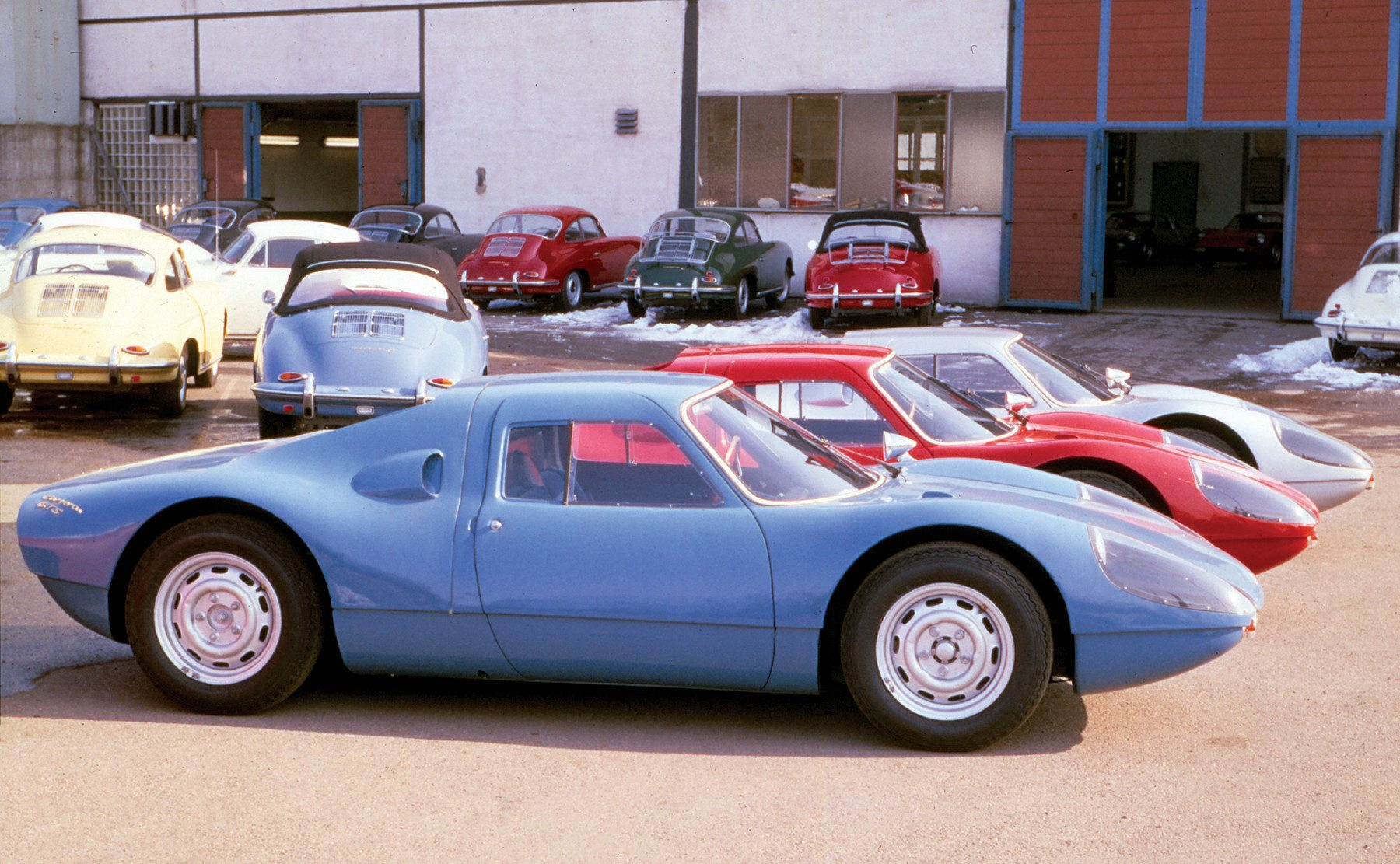 3 New 904 Porsche Carrera GTS Outside Factory