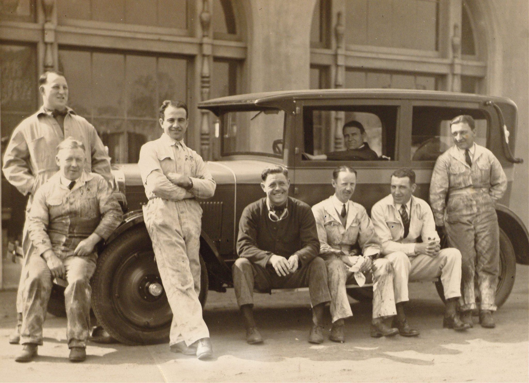 "Augie Duesenberg spent most of his time managing the Duesenberg Brothers racing department. He often hung around with his drivers and is pictured behind the wheel of a new Model A sedan with 1925 Indy 500 winner Peter DePaolo leaning on the left front fender. Also pictured are Babe Doyle (on front bumper), Phil ""Red"" Shafer and Wade Morton."