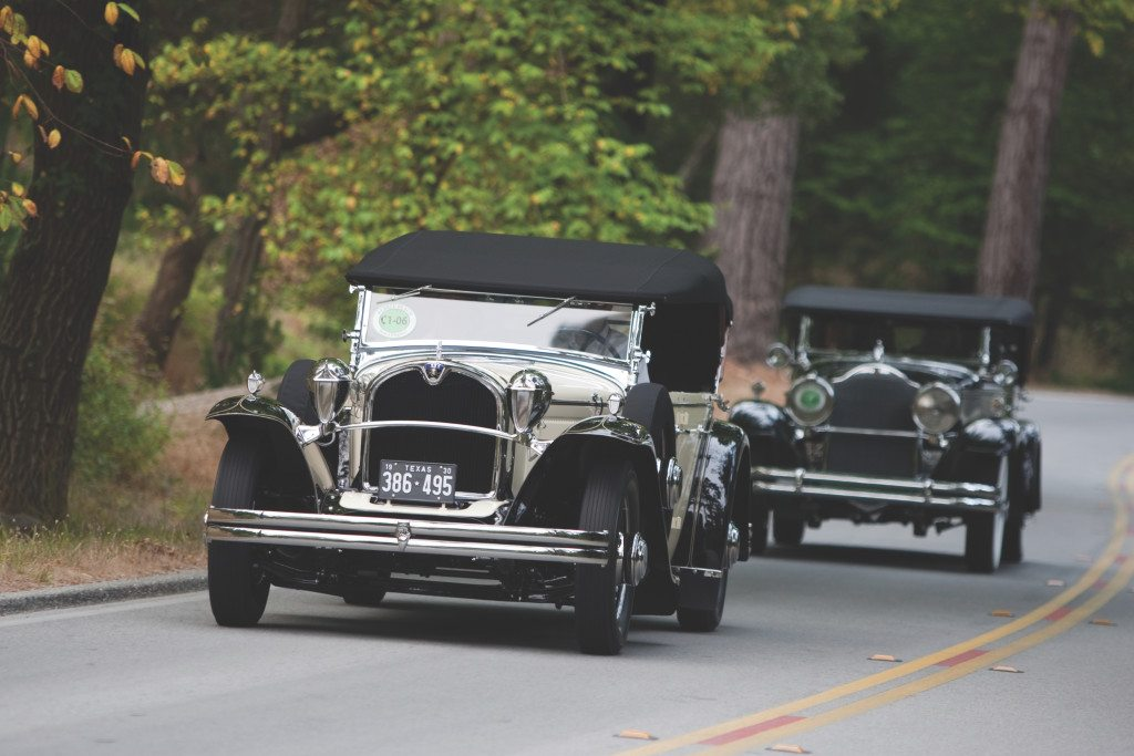 Classic cars being driven on the road