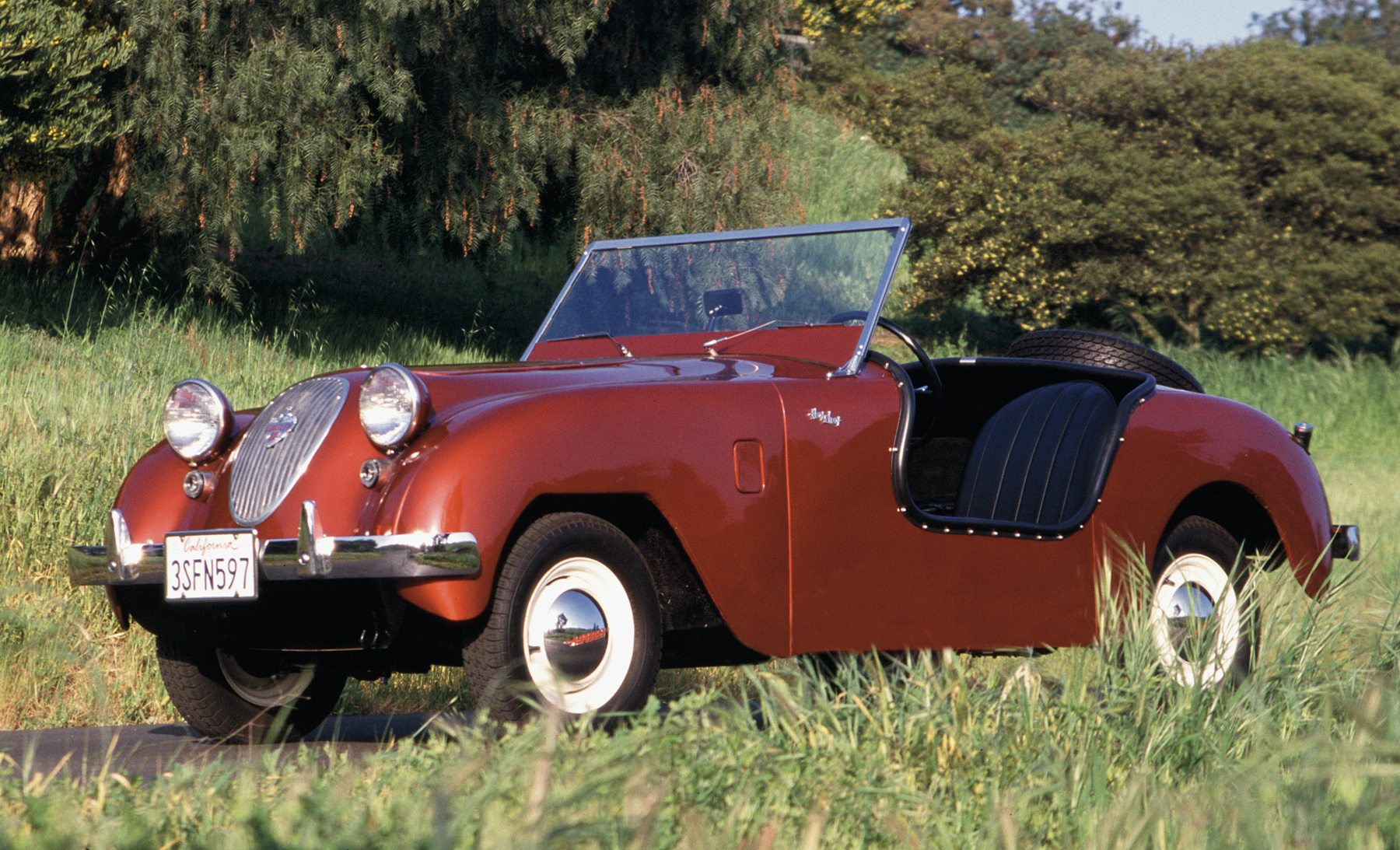 Crosley Hot Shot red roof down in grass