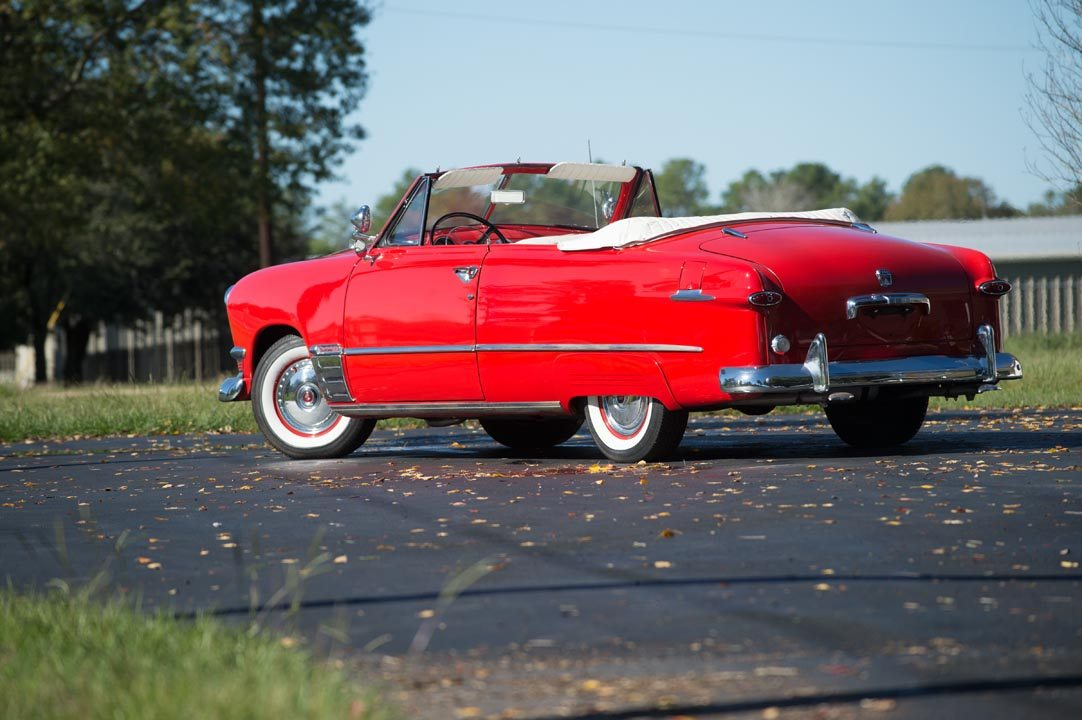 1950 Ford Custom Deluxe Convertible in bright red with rood down rear view