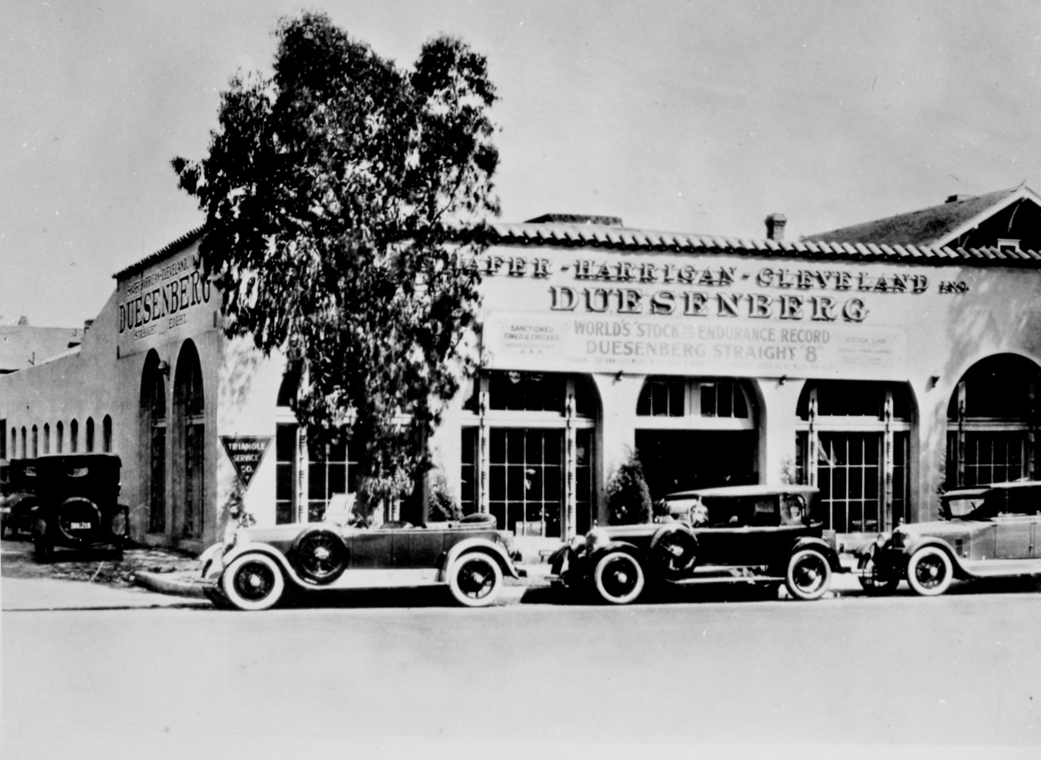 "Out West in sunny Southern California, Duesenberg sales were going strong, making Los Angeles one of the largest markets. Duesenberg chassis were also being fitted with custom bodies built in California or equipped with ""California tops"" such as the center model in this photo at the Shafer, Harrigan, & Cleveland, Inc. dealership in Los Angeles."