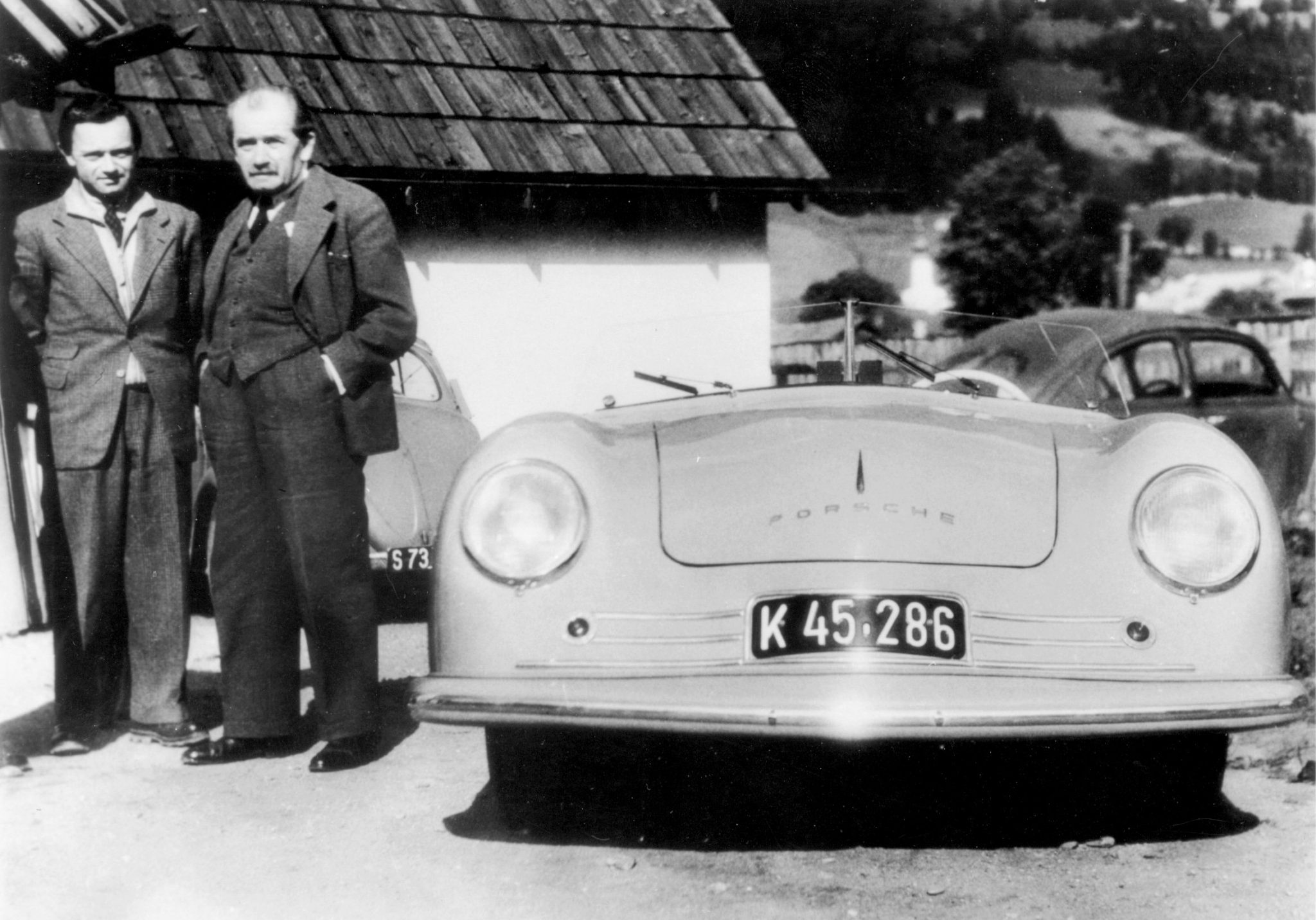 Ferry Porsche (left) and his father with the Gmünd roadster in 1948. His 20-month imprisonment had taken a toll on the elder Porsche's health. He was 73 years old when his son and the staff at Gmünd competed the fist car to bear the PORSCHE name across its hood.