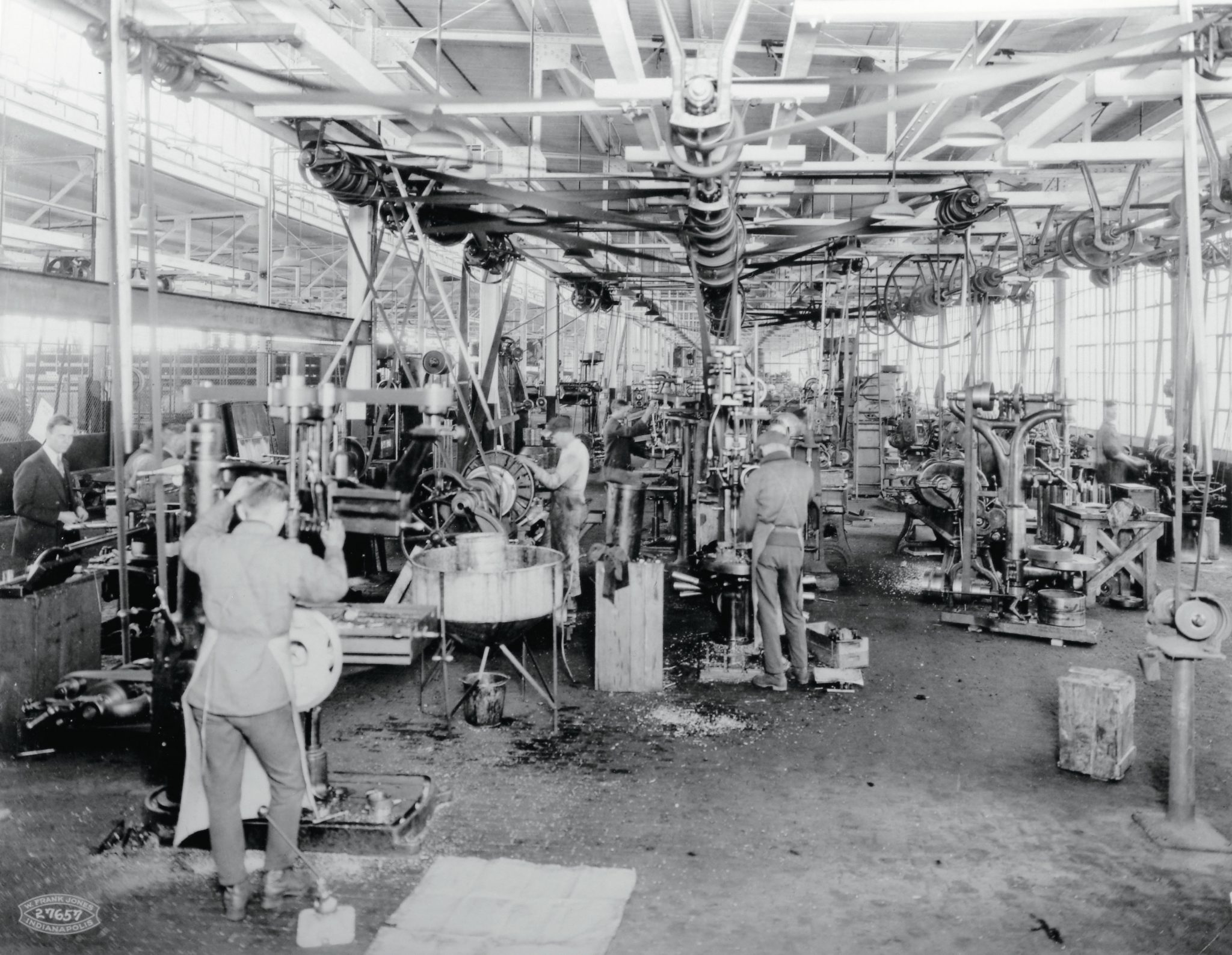 The new Duesenberg assembly plant in Indianapolis utilized the latest machinery available in 1921. This is the machine shop at Washington and Harding Streets. Note the complex overhead pulley system used to power all of the machines in the shop.